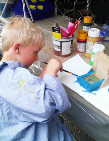Painting a bird feeder